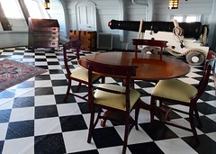 Dining with the big gun (gillybooze (Away)) Tags: ©allrightsreserved ship cannon hmsvictory navalhistory tables chairs nelson lamps ropes windows carpet portsmouth