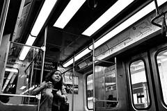 Green Line - CTA (draketoulouse) Tags: chicago loop people blackandwhite monochrome cta bw street streetphotography train city urban lights contrast woman female commute passenger
