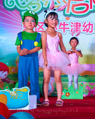 Happy Day Kindergarten Graduation 245 (C & R Driver-Burgess) Tags: stage platform ceremony parent mother father teacher child kids boy girl preschooler small little young pretty pink bunny mario luigi overallssing dance celebrate dress skirt red white blue bowtie 台 爸爸 妈妈 父亲 母亲 父母 儿子 女儿 孩子 幼儿 粉红色的 衬衫 短裤 篮球 跳舞 唱歌 漂亮 帅 好看 小 people gauzy compere 打篮球 短裤子 黑 红 tamronspaf2875mmf28xrdildasphericalif 6 5 4 yrsold text writing sign balloons ballet tights group lean reach 同学 班 tutu 兔子