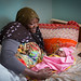 Sister Munaye Esmael holds her four-day-old son Umar Abdul Shafri at the UNICEF-supported Neonatal Intensive Care Unit (NICU)