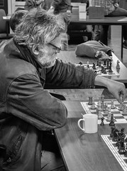 The Next Move (natures-pencil) Tags: person man beard glasses spectacles mug table chessboard chessmen chess game player spiel schaakspiel club move intellectual pastime hobby denksport moiradomtoren utrecht thought competition contest fight