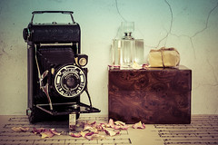 A moment in time (hehaden) Tags: camera vintage coronet box wooden perfumebottle soap rosepetals music photoboard