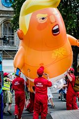 Babysitters (Sean Batten) Tags: london england unitedkingdom gb europe city urban trump protest balloon red people streetphotography street nikon df 50mm demonstration parliamentsquare