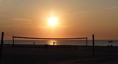 Sunrise Framed by Net (Rain Love AMR) Tags: sun sunrise beach ocean silhouette