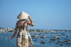 Vietnamese lady with Ao Dai Vietnam traditional dress and conical hat wait at the harbor, Fishing Harbour Mui Ne Vietnam (Patrick Foto ;)) Tags: ao asia asian back background beach beautiful beauty behind boat boats coast concept conical culture dai day dress elegant female field fishing harbour hat icon lady mui nature ne ocean outdoor outdoors people person pretty rear standing summer tourism tourist travel unrecognizable vacation vietnam vietnamese view waiting water woman young thànhphốphanthiết bìnhthuận vn