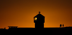 Lighthouse of the rising sun (ajecaldwell11) Tags: xe3 sunrise ankh dawn orange light hawkesbay silhouette napier beacon people sky peach newzealand caldwell fujifilm perfumepoint