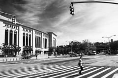 Crossing the street at Yankee Stadium (sirwoodland) Tags: streetphotography street nyc newyorkcity yankeestadium bronx thebronx usa newyork photography monochrome blackwhite crossing road intersection people sunny stoplights yankees