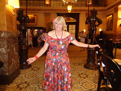 What This Drab Old Hotel Needs Is A Bold Splash Of Color (Laurette Victoria) Tags: dress floralprint woman lady laurette necklace blonde hotel lobby milwaukee pfisterhotel