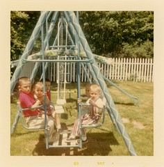Backyard Swingers, July 1965 (Alan Mays) Tags: ephemera photographs photos foundphotos colorphotos snapshots portraits children boys girls swingsets swings swinging swingers slides toys backyards yards lawns grass fences squinting squinters squint sunlight sunny bright blue green red july 1965 1960s old vintage