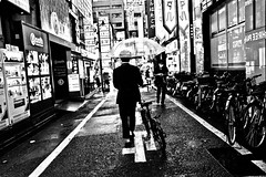 Shinjuku Blues...... (Victor Borst) Tags: street streetphotography streetlife reallife real realpeople asia asian asians faces face candid travel travelling trip traffic traveling urban urbanroots urbanjungle blackandwhite bw mono monotone monochrome rain raw rainy raining shinjuku tokyo blues city cityscape citylife japan japanese fuji fujifilm xpro2 expression