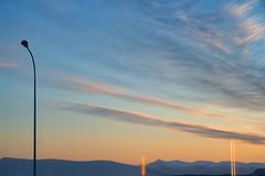 May 11th, 4:40 AM (pni) Tags: sunrise morning clud sky streetlight stg lamppost post horizon mountain fell reflection through reykjavik is18 iceland ísland pekkanikrus skrubu pni view landscape