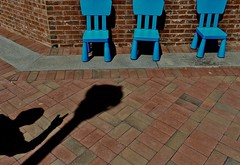 Is that seat taken? (tvdflickr) Tags: shadow chairs color nikon df nikondf photobytomdriggers tvdimages thomasdriggersphotography bricks courtyard city