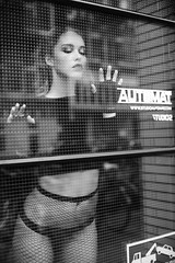 Victoria 2018 #8 (mobile_gwenster) Tags: nikon 50mm 5012ais manualfocus manualexposure monochrome highcontrastblackwhite highcontrast highcontrastmonochrome reflection window reflections daylight model beautiful woman sexy fishnet top