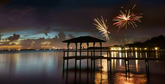 Fireworks along the Indian River Lagoon. (Jill Bazeley) Tags: fourth july fireworks indian river lagoon intracoastral waterway brevard county space coast merritt island florida reflection sunset sony a7rii 1018mm a7r2 dock pier boathouse silhouette