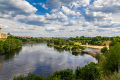the Narva river (kirill3.14) Tags: castle russia border water outdoor town clouds trees ivangorod narva fortress river beach sky bikes summer estonia frontier reflection