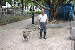 Dog walker (AntEater Theater) Tags: dogs elderly tired dogwalkers zhongshan old taipei taiwan streetphotography