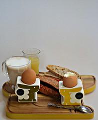 2018 7DWF: Eggs-actly (dominotic) Tags: 2018 breakfast food eggsactly crazytuesdaytheme coffeeobsession 7dwf boiledeggs bunnyeggcup woodenbunnyservingtray bbqsausages coffee toast cloudyapplejuice circle yellow meal yᑌᗰᗰy coffeecup sydney australia