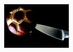 crumbs (overthemoon) Tags: bread football worldcup mondial breadbun knife stabbed dark utata ip 266 ironphotographer utata:project=ip266 frame paindesils