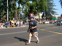 Independence Parade 335 (mfnure31) Tags: umbrella citystreet camera cameraman forthofjulyparade parade spectators california ontario crowd