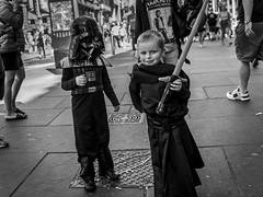 The Dark Side (Leanne Boulton) Tags: people urban street candid portrait groupshot portraiture streetphotography candidstreetphotography candidportrait streetportrait eyecontact candideyecontact streetlife glasgowcomiccon2018 comiccon comic convention costume cosplay outfit starwars character lightsaber kyloren darthvader child children face faces expression fun play playing tone texture detail depthoffield bokeh dutchangle naturallight outdoor light shade shadow city scene human life living humanity society culture lifestyle canon canon5dmkiii 35mm ef2470mmf28liiusm black white blackwhite bw mono blackandwhite monochrome glasgow scotland uk