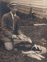 """NW Traverse City MI RPPC c.1910 VERY RARE Orson PECK with RARE Photographers Stamp on Rear Real Photographic RPPC Handsone Young Man CLEANING FISH ON TOP OF A CHERRY LUG1 (UpNorth Memories - Donald (Don) Harrison) Tags: vintage antique postcard rppc """"don harrison"""" """"upnorth memories"""" upnorth memories upnorthmemories michigan history heritage travel tourism restaurants cafes motels hotels """"tourist stops"""" """"travel trailer parks"""" cottages cabins """"roadside"""" """"natural wonders"""" attractions usa puremichigan """" """"car ferry"""" railroad ferry excursion boats ships bridge logging lumber michpics uscg uslss"""