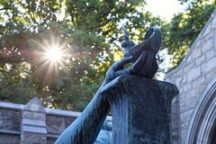 Devotion (MarcBphotos) Tags: devotion light star spiritual hand lamp woman arm chapel trees bokeh sun beam statue