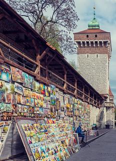 Street Seller & Florian Gate (13th Century Watchtower) (Krakow Old Town) (Cross Process Effect) (Olympus OMD EM1 II & M.Zuiko 12-100mm f4 Pro Zoom)