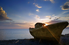 Abandoned (Bo.Th) Tags: beach blue boat bay sky seaside sea seascape silence sun sunset landscape colors clouds calm coast dock water weather abandoned light forgotten greece