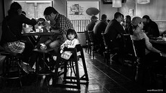 Lunchtime at the Ramen House (evanffitzer) Tags: lasvegas fujifilmx100s fujix100s bw blackandwhite mono monochrome dark restaurant food streetphotography street kids eat vegas nevada noodles indoors