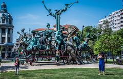 2018 - Romania - Bucharest - The Straw Carriage - 1 of 3 (Ted's photos - For Me & You) Tags: 2018 bucharest nikon nikond750 nikonfx romania tedmcgrath tedsphotos vignetting grupulstatuar căruțacupaiațe căruțacupaiațedinbucurești statutorygroup thestrawcarriageinbucharest bucharestromania bucurestiromania bucuresti sculpture bronzesculpture streetscene street flag romanianflag shadow shadows caraglewithstruts lucacaragiale caragiale neneaiancu ionlucacaragiale ioanbolborea red redrule