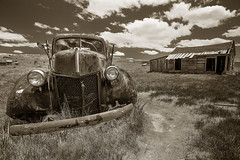 Bodie Composition (CameraOne) Tags: truck relic antique sepia raw monochrome blackandwhite wideangle cameraone bodie owensvalley california bodieghosttown urbex urbandecay clouds canon6d canonef1740mm 1930s outdoor sunny polarizer shack grass rust statepark arresteddecay headlights