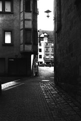 It shines through (Leica M6) (stefankamert) Tags: stefankamert street noir noiretblanc film analog grain light mood people alley leica m6 leicam6 summitar rollei retro 400s rottweil tones city sun shadows blackandwhite blackwhite