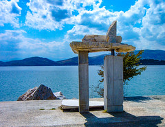 Art sculpture near the Sea (Shawn Blanchard) Tags: art sculpture piece sky clouds mountains sea water ocean rocks design volos greece mediterranean europe sun blue rock statue stone