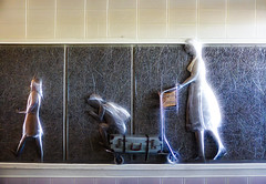 Doing the Light Fantastic (Steve Taylor (Photography)) Tags: wall sculpture nelson airport nz trolly suitcase straps backpack basket bright happy southisland newzealand glow texture tile hair