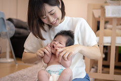 Mother and baby girl playing together (Apricot Cafe) Tags: img95701 asia asianandindianethnicities healthcareandmedicine healthylifestyle japan japaneseethnicity tamronsp35mmf18divcusdmodelf012 tokyojapan affectionate anticipation baby babygirls beautifulwoman beginnings bonding care colorimage cute day diaper domesticlife family fragility gift happiness indoors innocence lifestyles livingroom lookingatcamera loveemotion loveatfirstsight mother newlife newborn onlywomen pajamas people photography playing realpeople sitting smiling threequarterlength togetherness toothysmile twopeople women youngadult