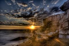 Guiding light (pauldunn52) Tags: sunset ogmore by sea glamorgan heritage coast wlaes long exposure clouds cliffs spray flare