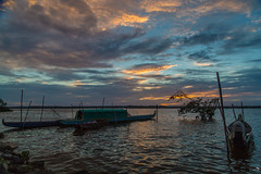 Tropical Sunset (alain_did) Tags: sunset sun water boat pirogues lueurs réflections clouds amazonian ameriquedusud guyanefrancaise saintlaurentdumaroni beauty photographie photooftheday ombres berge littoral naturallight