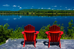 Except Two (jah32) Tags: red cmwdred colour color colours colors colourful summer summertime summercolours summercolour summerskies blue fredericton newbrunswick canada chairs chair muskokachairs muskokachair adirondackchairs stjohnriver water river rivers