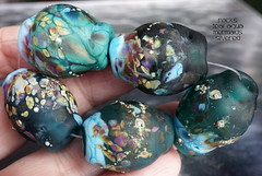 Rocks Teal Aqua Mermaids Silvered (Laura Blanck Openstudio) Tags: openstudio openstudiobeads glass handmade lampwork murano fine art arts artist artisan beads set opaque matte frosted etched glow glowing rocks nuggets pebbles stones whimsical funky odd abstract asymmetric speckles frit raku sterling silver silvered aqua blue turquoise mermaid rainforest green jungle pine bottle emerald lilac lavender mauve grape fuchsia purple violet eggplant plum ocher brown colorful multicolor