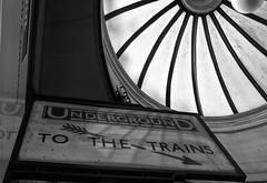 Upside Down (tcees) Tags: claphamcommon undergroundstn london sw4 sign skylight light londontransport sky tube x100 fujifilm finepix bw mono monochrome blackandwhite urban reflection northernline window text architecture building