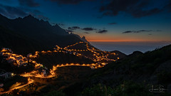 Tenerife Dusk (lsten) Tags: grass rock spring 19mm amazing nature water city hills theunforgettablepictures streetview canaryislands tripod spain nocturnal canoneos5dmarkiv sky view wideangle taganana peaceful cliffs travelphotography mountains dusk cloudes sea nightsky canonef1635mmf4lisusm rocks iso400 longexposure shore viewingpoint scenery mystical road forest f13 ridge tenerife green leóndetaganana colors dark mountain