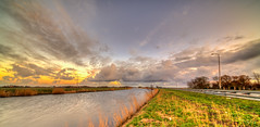 Clouds going after the setting sun. (Alex-de-Haas) Tags: 11mm d850 dutch hdr holland irix nederland nederlands netherlands nikon noordholland noordhollandschkanaal schoorldam avond beautiful beauty canal cloud clouds evening hemel kanaal landscape landschap longexposure lucht mooi skies sky sundown sunset water winter wolk wolken zonsondergang