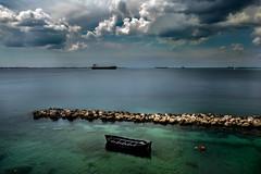 Gulf of Taranto, Apulia. Southern Italy (Claudio Abate) Tags: ioniansea seascape seaport boat ships breakwater taranto apulia fujifilm fujifilmxe3 clouds