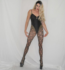 Trying to look dangerous... (queen.catch) Tags: dragqueen catchqueenyoutube bathing suit black lycra heels fishnets pantyhose pattern pleasers wig makeup shemale crossdresser drag ladyboy leotard allblack sissy feminization genderplay