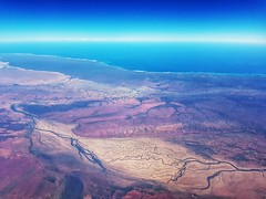 Jupiter or Western Australia? (Paul Threlfall) Tags: fokker100 flying westernaustralia wa throughawindow indianocean