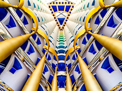 Opulence [Explored] (Marc Rauw.) Tags: dubai burjalarab burj luxurious luxury opulence opulent golden gold rainbow colourful colorful colors colours richness rich hotel floors building architecture art overthetop symmetry symmetrical geometry looking up ascending travel blue yellow olympusomdem10 olympus omd em10 mzuiko918mm mzuiko 918mm microfourthirds m43 μ43 unitedarabemirates abundance wealth wealthy arab vshape v interior grandeur atrium uae