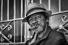 The Cuban cliché (karmajigme) Tags: man cuban cigar hat human portrait travel cuba trinidad monochrome noiretblanc blackandwhite bw nikon