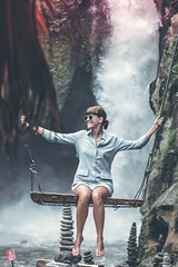 Beautiful woman swings near waterfall in the jungle of Bali island, Indonesia. (Artem Bali) Tags: swing woman waterfall sitting water jungle nature travel river green tree beautiful outdoor park summer forest background tourism rainforest landscape stone natural lake adventure beauty fresh rock tropical swinging freshness peaceful elegant motion fun extreme happiness jump joy environment morning fall south sky beautyinnature freedom asia happy spring bali hanging