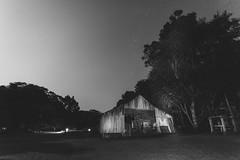 The night shed. (Pablin79) Tags: night light moonlite moonlight sky dark stars longexposure trees monochrome black white grey cuñapirulodge aristobulodelvalle misiones argentina outdoors summer nightscape barn shed wood shadows calm