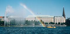 Rainbow over the Alster (Javier Pimentel) Tags: inneralster lagoalster see germany jungfernstieg rainbowoveralake arcoirissobrelago binnenalster rainbow regenbogen hapagloydbuilding alsterlake arcoiris hamburg hamburgo alemania yellowboat deutschland de